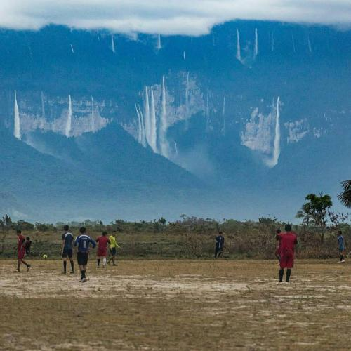 Would you like to enjoy a football match with that landscape in the background?