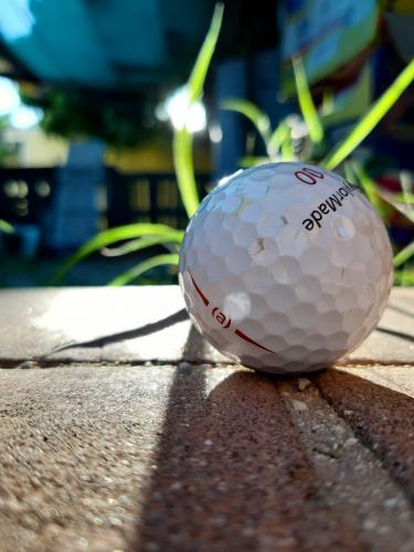The sun and the golf ball.